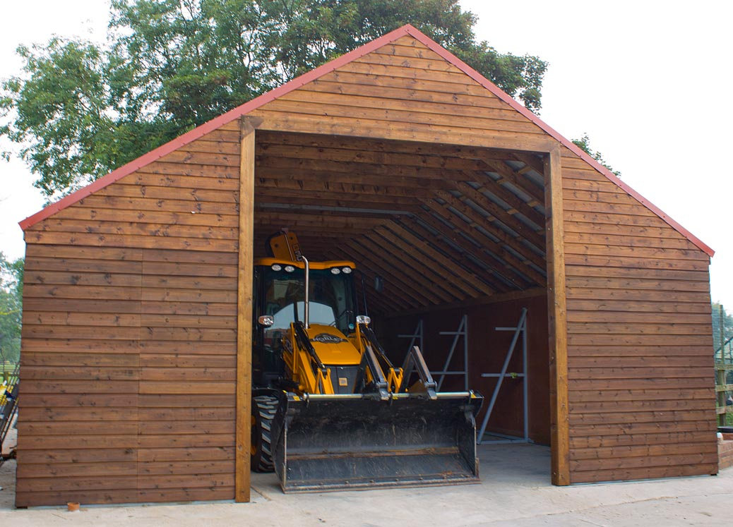 Timber Barn with JCB